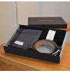 The giftbox contains a belt, pair of socks and a scarf.